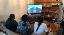 Sharing console gaming with Zoya and Nainamma (his grandma)